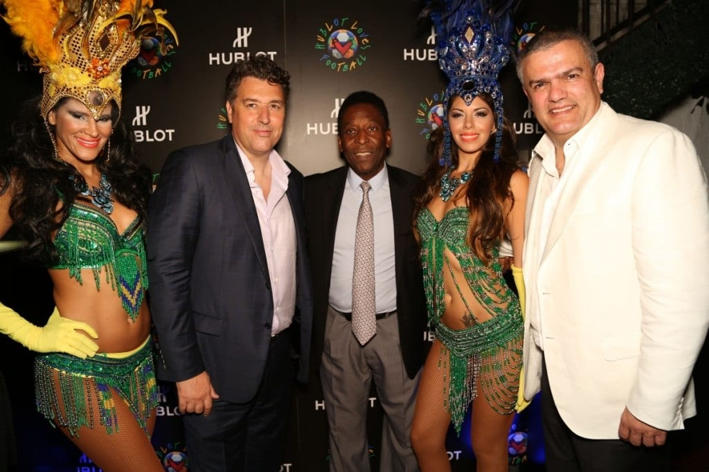 Picture of Rick De La Croix, Pelé and Ricardo Guadalupe pose with Carnival-themed dancers at a Hublot Loves Football event.