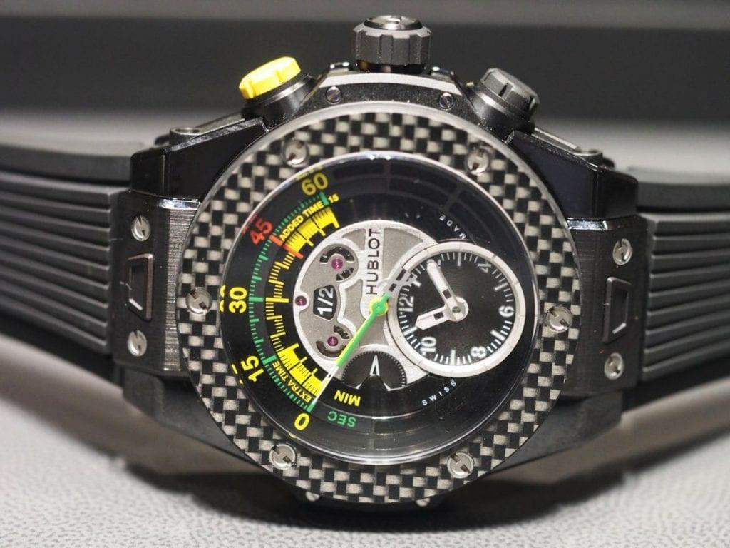 The arresting ceramic version of the FIFA WC Official Watch, the Big Bang Unico Bi-Retrograde Chrono Ceramic Carbon with Pele and Rick De La Croix.